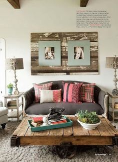 Recycled wood boards behind photo frames... love the texture and warmth this creates