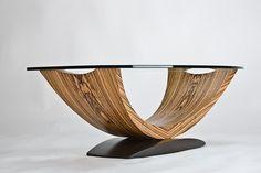 kurve studio: Arc coffee table (zebrano, santos mahogany)
