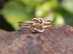 Love Knot Ring 14K Gold Filled Celtic Double Knot Bridesmaid Ring Friendship Ring by MountainMetalcraft on Etsy https://www.etsy.com/listing/162808667/love-knot-ring-14k-gold-filled-celtic