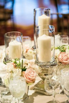 Tall White Candles in Glass Votives Wedding Centerpiece / http://www.deerpearlflowers.com/wedding-ideas-using-candles/2/