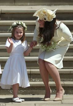 The mother and daughter were picture perfect as they waved off Harry and Meghan following ...