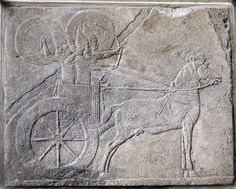 Assyrian chariot with charioteer and archer protected from enemy attack by shield bearers (Pergamon Museum, Berlin)