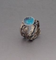 Handmade Sterling silver ring with enameled focal piece . aqua,blue and purple transparent enamels over circles texture.