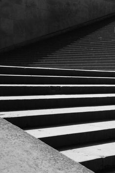 Staircase, in dark greys and blacks. Functional simplistic design, but captured in an interesting perspective.