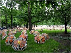 """Artist Victor Matthews painted a butterfly on open umbrellas and set them up in Battery Park, New York for his """"Beyond Metamorphosis"""" work. Home Crafts, Arts And Crafts, Umbrella Painting, Battery Park, Umbrellas Parasols, New York Photos, Under My Umbrella, Refurbished Furniture, Paper Lanterns"""