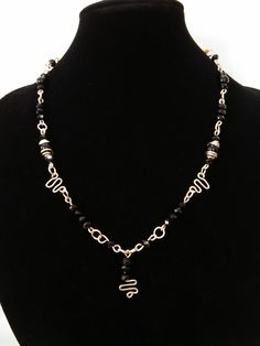 Wire work with black crystals, necklace.