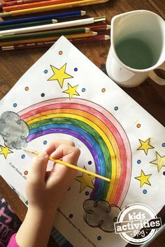 Play with colors and create your own pretty art with this free printable rainbow coloring page from Kids Activities Blog!