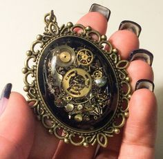 As Seen at GBK's 2015 MTV Movie Awards Steampunk Pendant Brass Filigree accent with chain filled with real recycled watch parts OOAK
