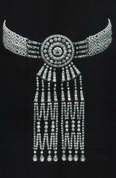 Cartier - A Belle Epoque platinum, diamond and pearl 'Cravate' necklace, Paris, circa 1909.