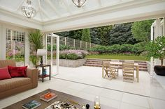 Mediterranean style sandy white porcelain tiles look fantastic when used to link conservatories and patios