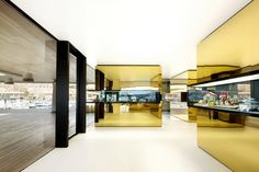 Five 'precious boxes', housing various functions, are the real gems in OHLab's Mallorcan jewellery store. These stainless steel-clad volumes with golden mirror finishes add a sense of tangible luxury to the space, which the jury cites as a 'very daring and well-proportioned project' while complimenting the designers for 'convincing the client that the architecture of a shop is at least as important as the merchandise'.