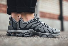 c3db210e1be614 The Nike Air Max Plus TN Ultra in black grey is showcased in a lifestyle  perspective. Find it at select Nike stores overseas first.