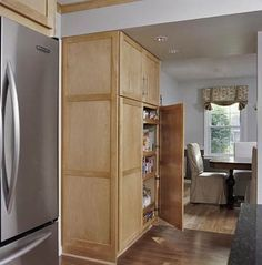 Kitchen Pantry Cabinets  -- love this huge storage unit but would need roll-out shelves to use all the great space!