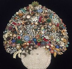 Super cool pic made out of vintage jewelry! This is what I am doing with my Grandma's old costume jewelry!! Love!