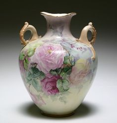 Belleek porcelain double handled vase hand painted with roses.