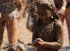 Thousands descend on Westland, Michigan, to play in a 23 metre by 46 metre sludge pit during the 25th annual Mud Day event