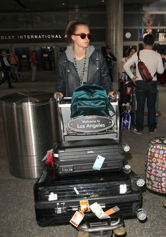 Actress Cara Delevingne traveling with her two RIMOWA cases at LAX airport.