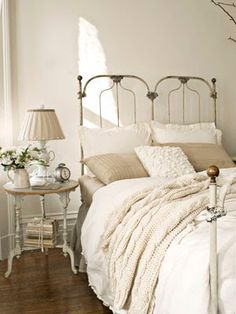Antique French Bedroom: This antique cast-iron bed sports a cable-knit throw from the Martha Stewart Collection and a duvet cover by French Laundry Home. An Anthropologie teacup lamp sits atop the turned-leg nightstand for a graceful, elegant touch. Bedroom Inspirations, Home Bedroom, Bedroom Design, Chic Bedroom, French Bedroom, Iron Bed, Victorian Home Decor, Home Decor, Country House Decor
