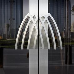Peter Marlow - United Arab Emirates, Dubai. The Armani Hotel Dubai. Entrance doors with the Armani logo. This photograph was taken in 2010.