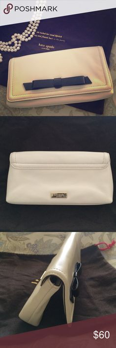 "💯authentic Kate Spade clutch Off white clutch, black lining with white bows and has 6 slots for credit cards or business cards. Magnetic closure. Great for date night! Can fit any size cell phone, lipgloss and keys. Measures 9"" wide by 4"" kate spade Bags Clutches & Wristlets"