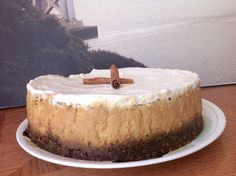 ... Pumpkin-Cheesecake-with-Marshmallow-Sour-Cream-Topping-and-Gingersnap