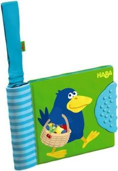 "HABA Orchard Baby Buggy books by Haba. $8.54. Age: 6m+. This bright and attractive colored book is perfect for fun out and about and at home! Attach to buggy, clothing, car seats, strollers and more! A teething element is also part of the book. Includes detachable hook and loop. Washable at 30 degrees C / 86 degrees F. Made of fabric.Product Measures: 5.79"" by 4.57"" by 1.26""Recommended Ages: 6 months and up"