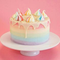 Unicorn Cake by Crumbs and Doilies:  funfetti sponge, rainbow ombre, white chocolate drizzle, and rainbow meringues