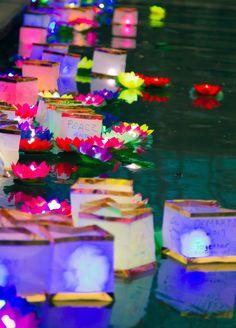 The casting of Confucius Wishing Lanterns on The San Antonio River Walk.