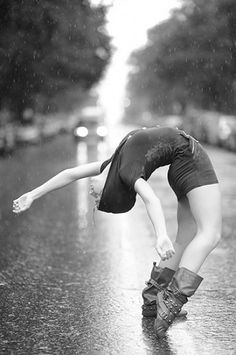 Go ahead and dance in the rain.     Dancer Tenealle Farragher photographed by Jordan Matter Photography.