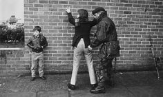 A British soldier searches a teenager in Belfast, Northern Ireland, during the Troubles in 1971