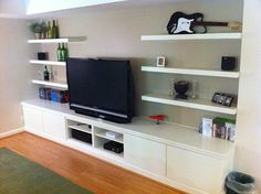 Ikea hack - 3 BESTA shelf units, 4 BESTA VARA drawer fronts, 6 Lack wall shelves - like the idea not the color and wouldn't want IKEA, but it's a thought for the TV room!