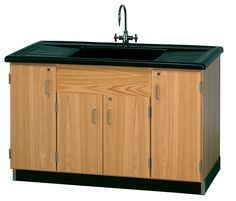 Clean Up Sink - One piece top including sink is molded of polyolefin. Polyolefin is easy to clean, extremely chemical resistant, and is highly impact resistant to reduce glassware breakage. The low temperature strength eliminates cracking with dry ice. The long grooved sloping counter leads to large sink in center.  (DW_3303K)