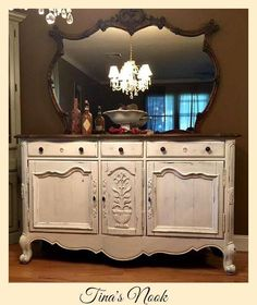 Gorgeous buffet refinished with a homemade chalk paint in chocolate for the top and white on bottom. Heavily distressed to perfection! Rustic shabby chic!! Feel free to join my facebook group. https://www.facebook.com/groups/TinasNook/