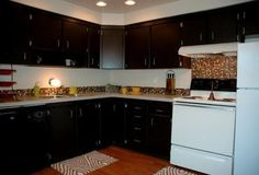 Carnaby Village Townhomes are beautiful Columbus apartments, located on McNaughten Road, just east of Basement For Rent, Townhouse, Apartments, Ohio, Kitchen Cabinets, The Unit, Home Decor, Columbus Ohio, Decoration Home