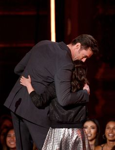 Hugh Jackman Photos Photos - Actors Hugh Jackman (L) and Dafne Keen accept the Best Duo award for 'Logan' onstage during the 2017 MTV Movie And TV Awards at The Shrine Auditorium on May 7, 2017 in Los Angeles, California. - 2017 MTV Movie And TV Awards - Show