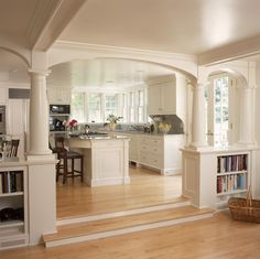 Like the idea of built-in shelves between kitchen and family room -- i can do this! White kitchen and breakfast room with fireplace and arches - traditional - kitchen - new york - by Huestis Tucker Architects, LLC Living Room And Kitchen Design, Living Room Designs, Kitchen Open Concept, Open Kitchen, Kitchen Windows, Nice Kitchen, Kitchen Island, Kitchen Columns, Awesome Kitchen