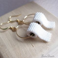 Toilet Paper earrings on gold, hook earrings Handmade beadwoven jewelry for the silly side of life ©2007-2012 LiciaBeads All rights reserved.