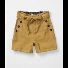 """Anthropologie Daughters of the Liberation Shorts. """"Breezy Paper Bag Shorts""""  Color: mustard yellow  Condition: Excellent  Fabric: 55% linen and 45% cotton  Measurements: 11 inch rise 4 inch inseam Waist measures 15 inches side to side while laying flat Shorts measure 15 inches from top to bottom  Comes from a non-smoking environment Anthropologie Other"""