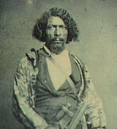 "He was the inspiration for the 2012 film ""Django Unchained"". He wore a black hat and carried twin .45 Colt Peacemakers. During his 32 year career as Deputy Marshal of the Oklahoma Territory, he was single-handedly responsible for capturing over 3,000 outlaws, once bringing in 17 men at one time. And in that period of time, never once did a bullet touch him. Read the story of Bass Reeves, THE REAL DJANGO, in my blog!"