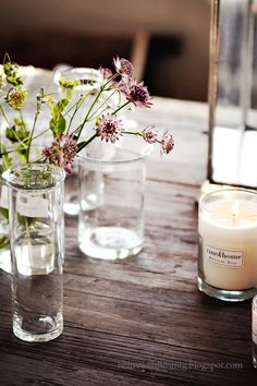 lovely mix ... scented candles, delicate buds and farmhouse table
