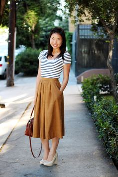Nothing is more classy than stripes and camel. Add red lipstick and you're timeless.