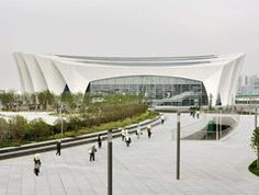 Completed in 2011 in Shanghai, China. Images by Marcus Bredt. The Shanghai Oriental Sports Center (SOSC) just celebrated its opening for the FINA World Swimming Championships from to July Stadium Architecture, Unique Architecture, Shanghai, Structural Model, Leisure Pools, Indoor Arena, Hotel Concept, Sports Complex, Indoor Swimming Pools