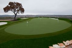 Stunning SYNLawn Golf backyard synthetic putting green with bunkers, fairway and rough.