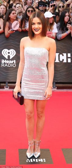 Thigh's the limit: Lucy picked a shimmering strapless silver mini-dress with matching heels for her appearance at the 2015 iHeartRadio Much Music Video Awards on June 19