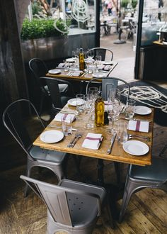 restaurant interior . rustic . tolix chairs | Get the same look with our Viktor chair and solid wood table tops!