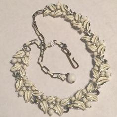 "Vintage white enamel necklace Vintage white enamel necklace Silvertone.    Could be Moran as a bracelet 15"" adjustable.  4000 Jewelry Necklaces"