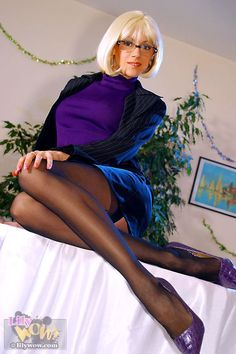 Leggy lady in sexy stockings tease on the desk
