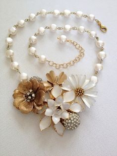 Vintage enamel flower necklace, cream, ivory, faux pearl, gold, Art Deco rhinestone, flower power, Statement necklace, floral bib by ChicMaddiesBoutique on Etsy https://www.etsy.com/listing/229950779/vintage-enamel-flower-necklace-cream