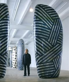 """This photo exemplifies the bold rhythmic patterns Jun Kaneko likes to use on the surface decoration of his giant """" 3d canvases """""""
