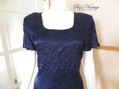 A personal favorite from my Etsy shop https://www.etsy.com/ca/listing/267389123/brocade-dark-royal-blue-90s-maxi